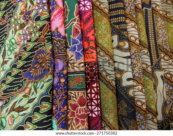 Colorful pile of batik fabrics or textiles