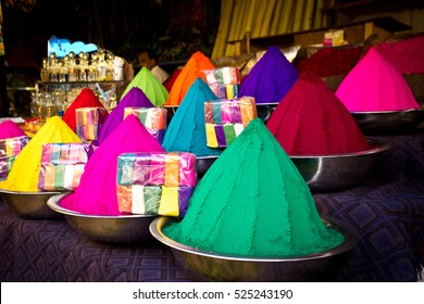 Colorful piles of powder sold on the market before Holi festival, Mysore, India