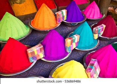 Colorful piles of powder sold on the market for Holi festival, Mysore, India