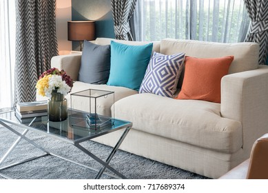 colorful pillows on modern sofa in modern living room, interior design concept