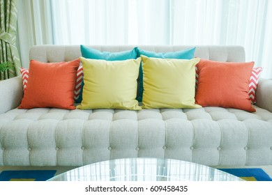 Colorful pillows on sofa in living room