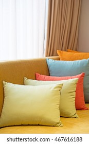 Colorful pillows set in room, selective focus