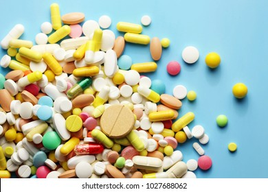 Colorful pills on a blue background