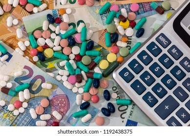 Colorful pills on euro banknotes dispersed, closeup