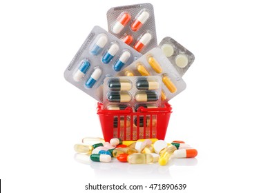 Colorful pills in shopping cart isolated on white background