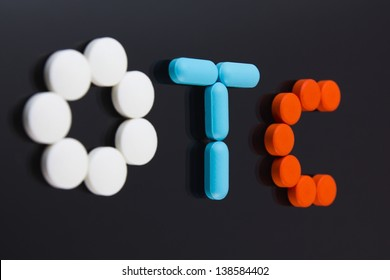 Colorful pills spell out OTC