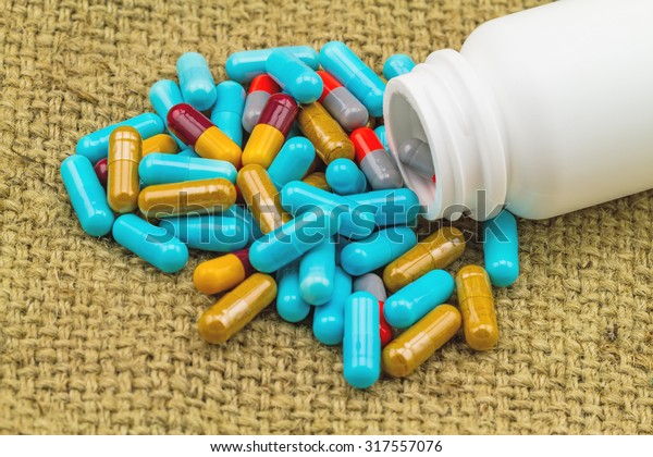 Colorful Pills White Bottle Tablets On Stock Photo (Edit Now