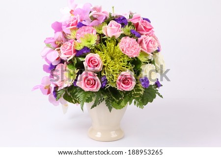 Colorful pink flower arrangement centerpiece roses stock photo edit colorful pink flower arrangement centerpiece with roses lily carnations isolated on white mightylinksfo