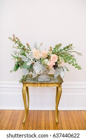 Colorful Pink and Green Flower Arrangement on an Antique Gold Table
