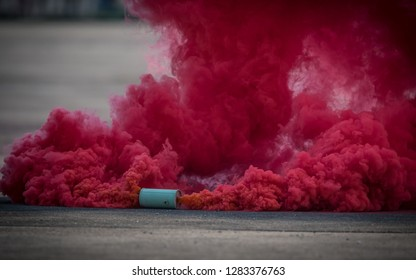 colorful pink smoke bombs action in showing.