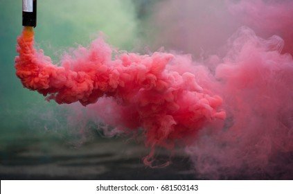 colorful pink smoke bombs in action