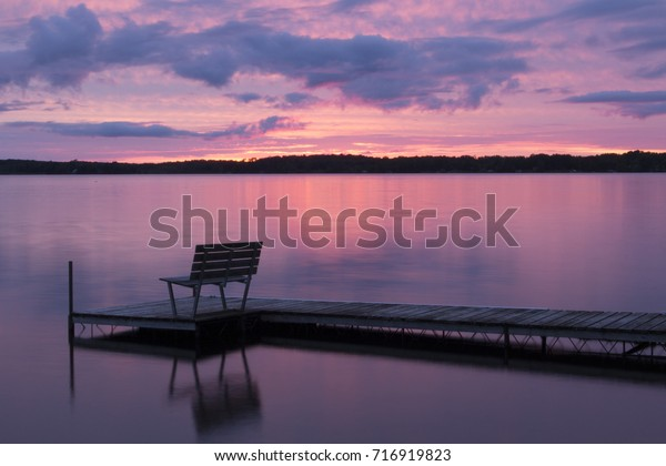 Colorful Pink Sunset Reflected Calm Waters Royalty Free
