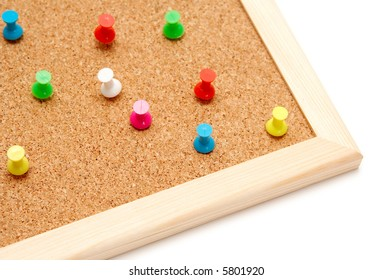 Colorful pins on a corkboard