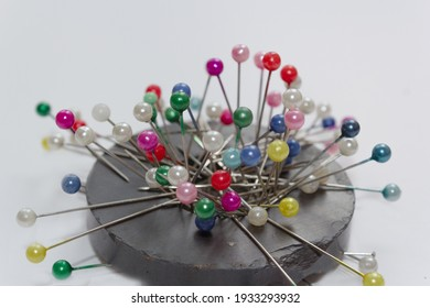colorful pins on ring magnet white background, magnetic pin cushion, tailor, sewing, fashion, design materials equipments, tools, diy, cloth fastening fabric, glass headed pin