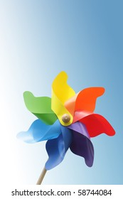 Colorful pinwheel against blue gradient background