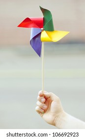 Colorful pinwheel in hand