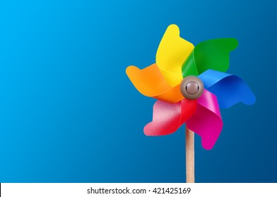 Colorful pinwheel isolated on the blue background with copy space