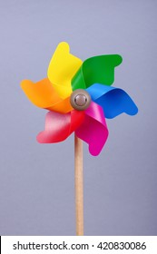 Colorful pinwheel isolated on the gray background