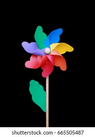 Colorful pinwheel over black background