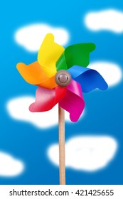 Colorful pinwheel over the watercolor sky childhood concept
