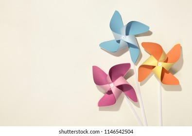 Colorful pinwheels on yellow background