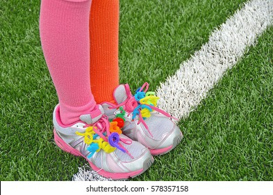 colorful pipe cleaner shoestring on sport shoe with colorful socks