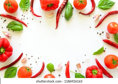 Colorful pizza ingredients pattern made of tomatoes, pepper, chili, garlic and  basil on white background. Cooking concept. Top view. Flat lay. Copy space