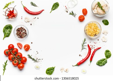 Colorful pizza ingredients. Tomatoes, cheese, chilli peppers and basil leaves on white background, top view, free space - Shutterstock ID 1306518025