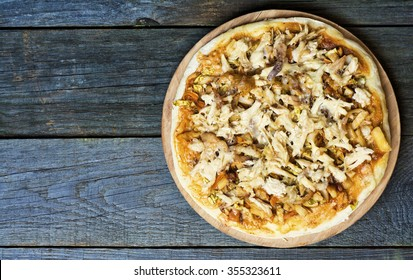 Colorful pizza with mozzarella cheese, chicken, sweet pepper and parsley close up top view. Italian cuisine home cooking. toned image