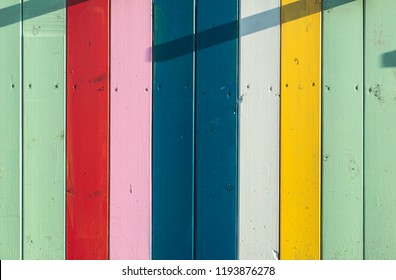 Colorful planks background. Sunny day