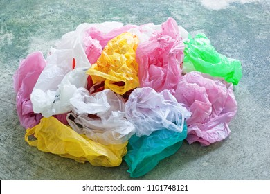 Colorful plastic bag on cement floor background.