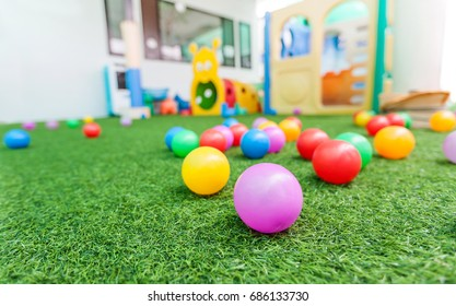 colorful plastic ball for kids on green turf at school playground