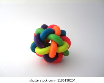 Colorful Plastic Ball made with intertwined plastic tubes Isolated On A White Background