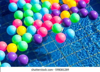 Colorful plastic balls in pool , pool villa house.
