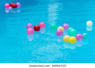 Colorful plastic balls in swimming pool