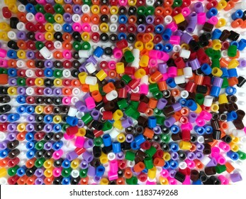 Colorful plastic beads is raw materials of chemical industries include polyethylene,polypropylene,polystyrene and polyvinyl chloride.Concept for industry and factory.