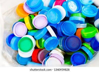 Colorful Plastic bottle caps in plastic bag ,plastic recycle