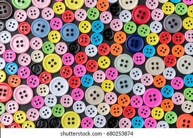 Colorful plastic bottons arranged for background.