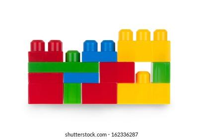 Colorful plastic bricks isolated on white background