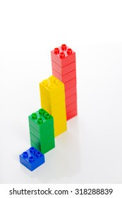 Colorful plastic building bricks on white background
