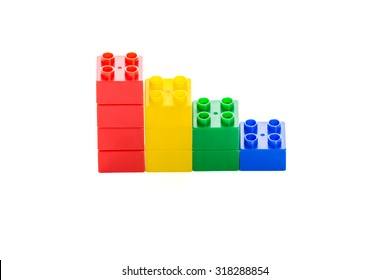 Colorful plastic building bricks on isolated white background