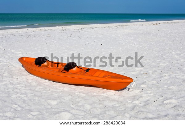 colorful-plastic-canoe-on-white-600w-286