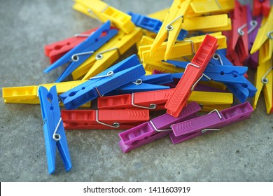Colorful Plastic Clothespins, Clothes Pegs, Clothespins Collection, Background and Texture of Scattered Clothespins, Lots of Clothespins