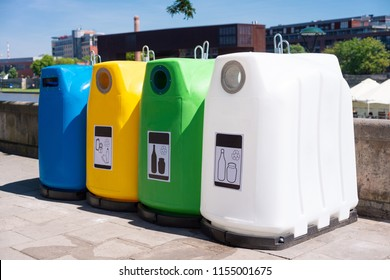Colorful plastic containers in a row for separate garbage collection