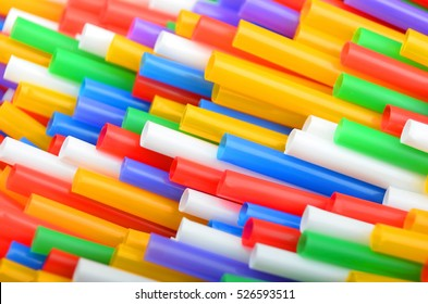 Colorful plastic drinking straws, close up as background