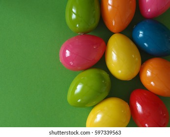 Colorful Plastic Easter Eggs On A Paper Background With Space For Text