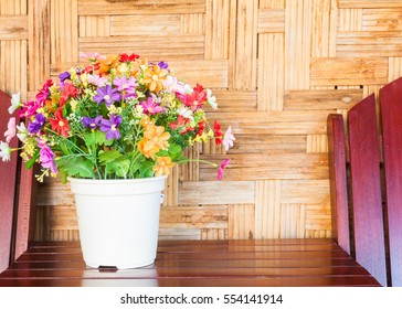 colorful plastic flower bouquet with bamboo weave background.