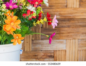 colorful plastic flower bouquet, front focus and blurry background,you can add your text.