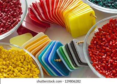 Colorful plastic granules and finished plastic plates
