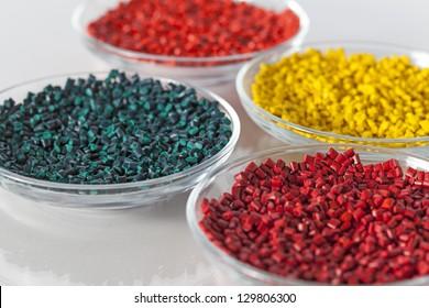 Colorful plastic granules in glass